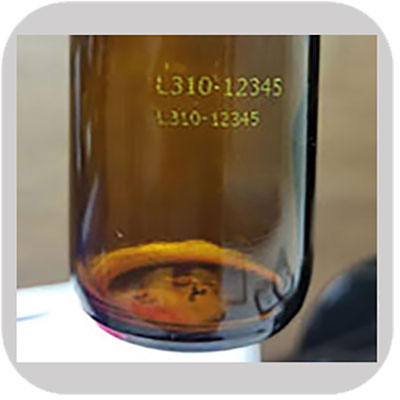 Industrial printing on Glass Bottle with yellow solvent ink