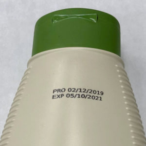 Industrial coding and marking on plastic hand cream bottle